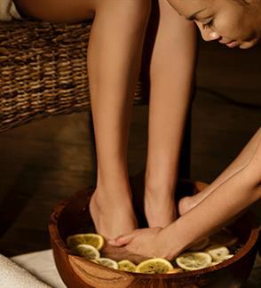 Refleksologinis pėdų masažas